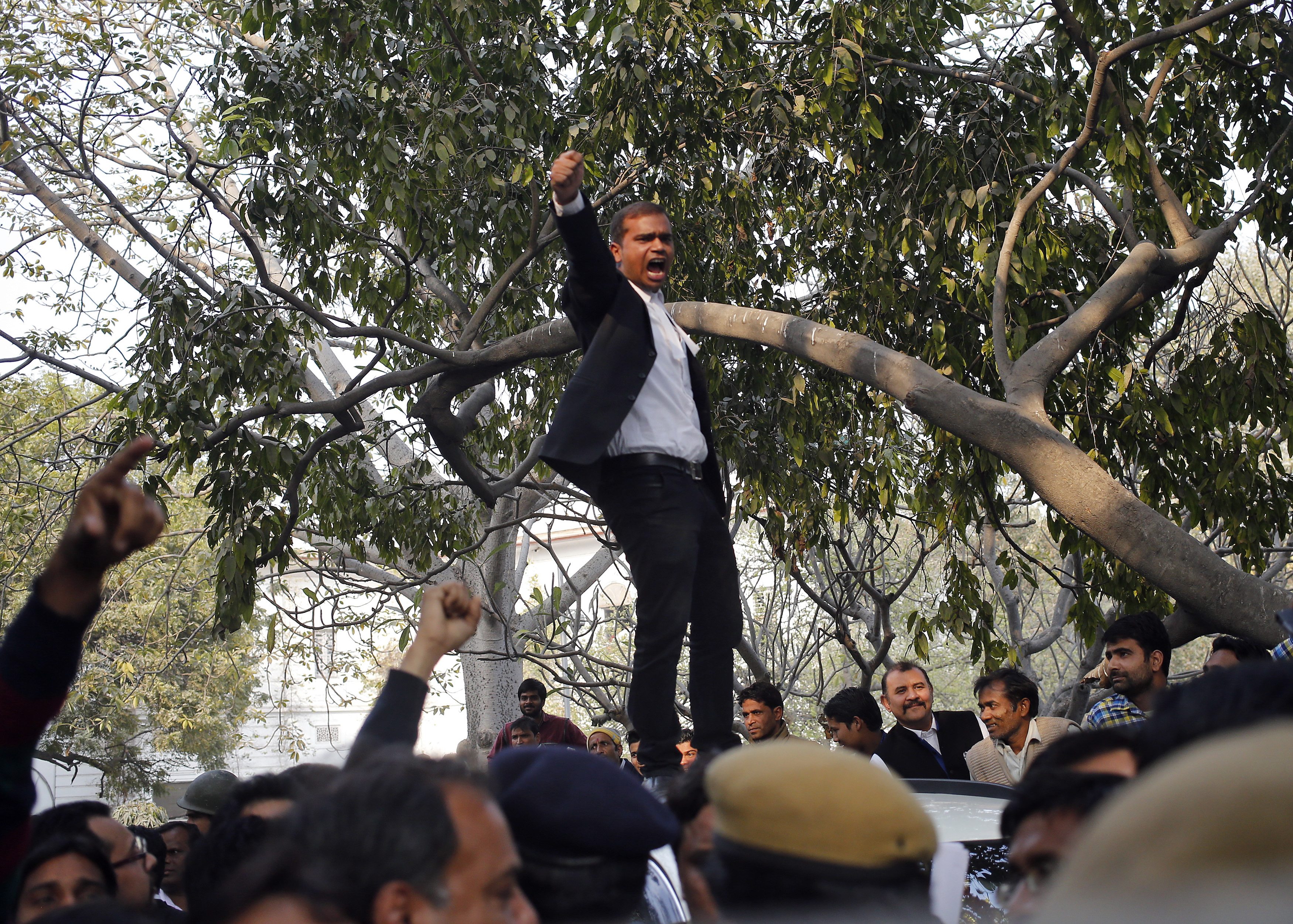 A lawyer shouts slogans during a protest outside the Patiala House court in New Delhi, India. February 17, 2016. Fighting broke out on Wednesday around Delhi's Patiala House court hearing a case against a Jawaharlal Nehru University student union leader accused of sedition, a charge that has sparked protests across university campuses and criticism the government was curtailing free speech. REUTERS/Anindito Mukherjee - RTX27CD1