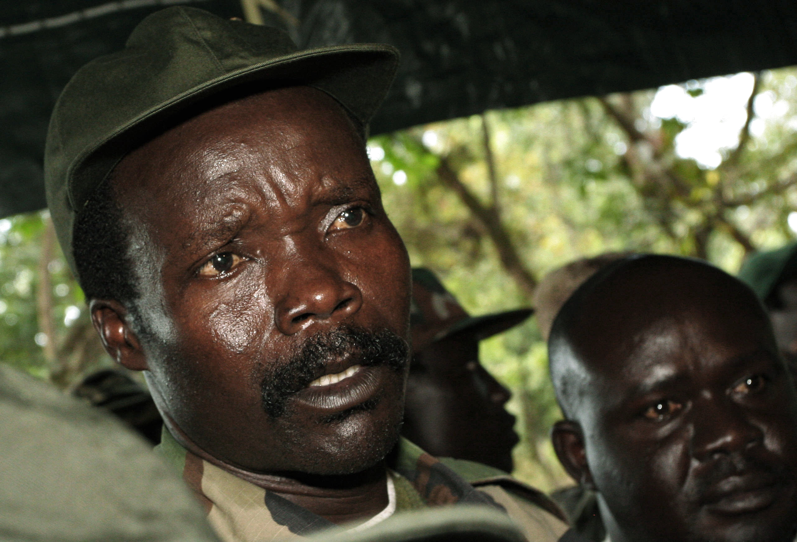 Leader of the Lord's Resistance Army Joseph Kony speaks to journalists after a meeting with U.N. humanitarian chief Jan Egeland at Ri-Kwamba in southern Sudan November 12, 2006. Egeland held a brief and heated jungle meeting with the elusive head of Uganda's Lord's Resistance Army on Sunday but failed to win immediately two of the concessions he was seeking. REUTERS/Stuart Price/Pool (SUDAN) - RTR1JA2B