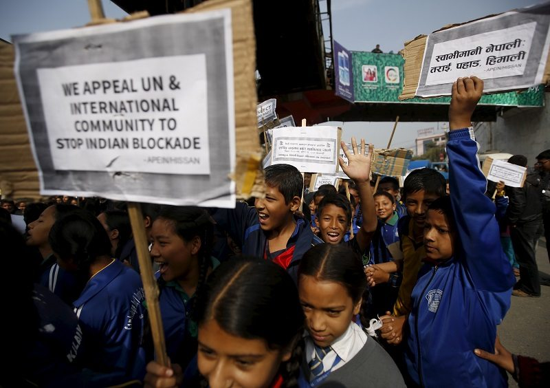 Nepalese students holding placards take part in a protest to show solidarity against the border blockade in Kathmandu, Nepal November 27, 2015. The middle hills and the capital Kathmandu have suffered fuel and cooking gas shortages after protesters in the south switched to blocking supplies from India, Nepal's largest trading partner, almost two months ago. Many in Nepal accuse India of supporting the protesters - a charge New Delhi denies. India has expressed its dissatisfaction with parts of the constitution, although it also says it cannot allow trucks to enter Nepal while conditions are unsafe. REUTERS/Navesh Chitrakar - RTX1W3C4