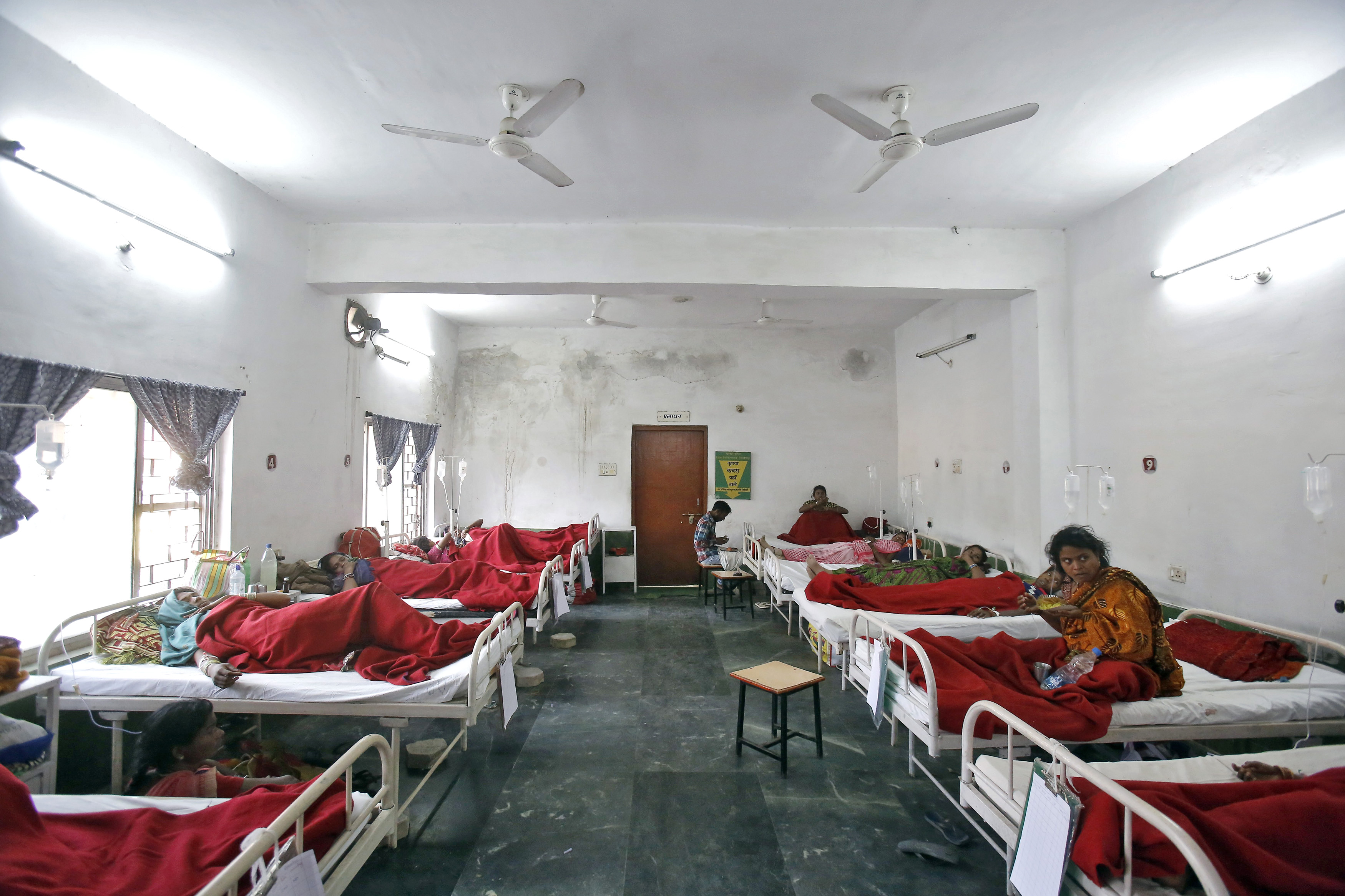 """Women, who underwent a sterilization surgery at a government mass sterilisation """"camp"""", lie in hospital beds for treatment at Chhattisgarh Institute of Medical Sciences (CIMS) hospital in Bilaspur, in the eastern Indian state of Chhattisgarh, November 13, 2014. The doctor whose sterilisation of 83 women in less than three hours ended in at least a dozen deaths said on Thursday the express operations were his moral responsibility and blamed adulterated medicines for the tragedy. Dr R. K Gupta, who says he has conducted more than 50,000 such operations, denied that his equipment was rusty or dirty and said it was the government's duty to control the number of people that turned up at his family-planning """"camp"""". REUTERS/Anindito Mukherjee (INDIA - Tags: HEALTH CRIME LAW SOCIETY) - RTR4DYN3"""