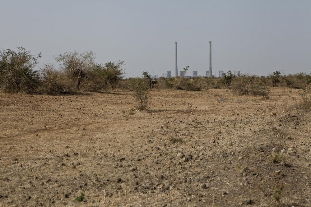 In the background is a thermal power plant built by Indiabulls Power Ltd in the parched Amravati district.