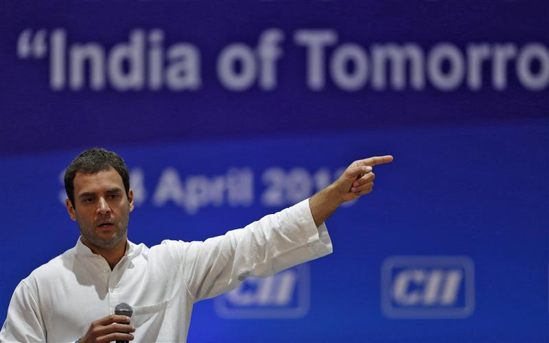 Gandhi gestures during the annual general meeting and national conference 2013 of Confederation of Indian Industry in New Delhi