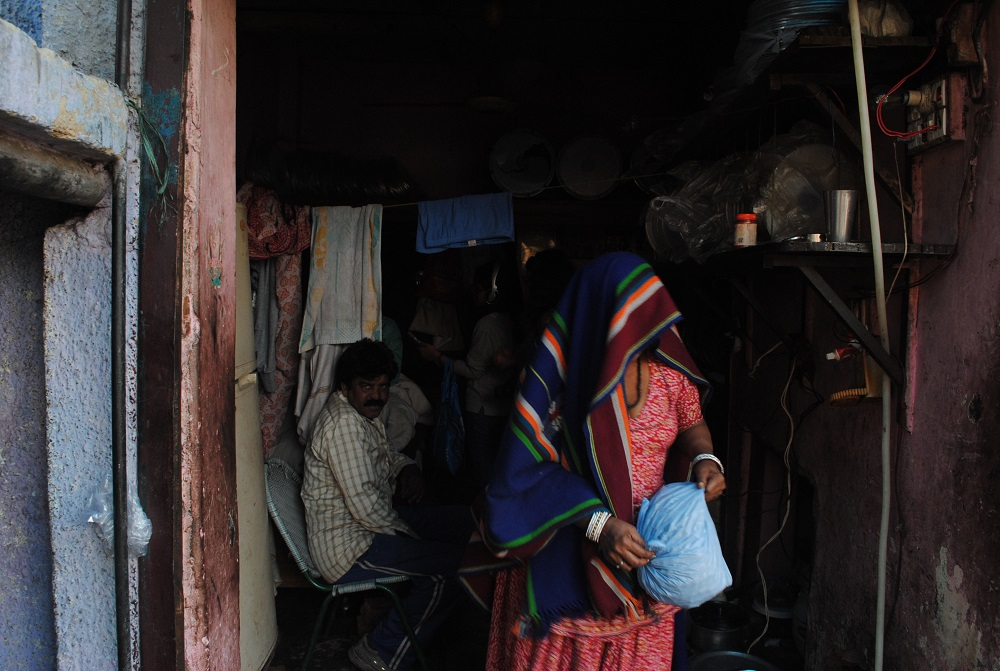 A women in a Kathputli colony house