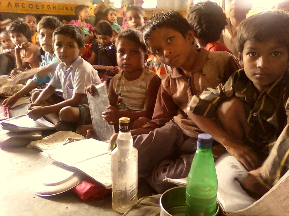 Students in classroom, waiting for teacher