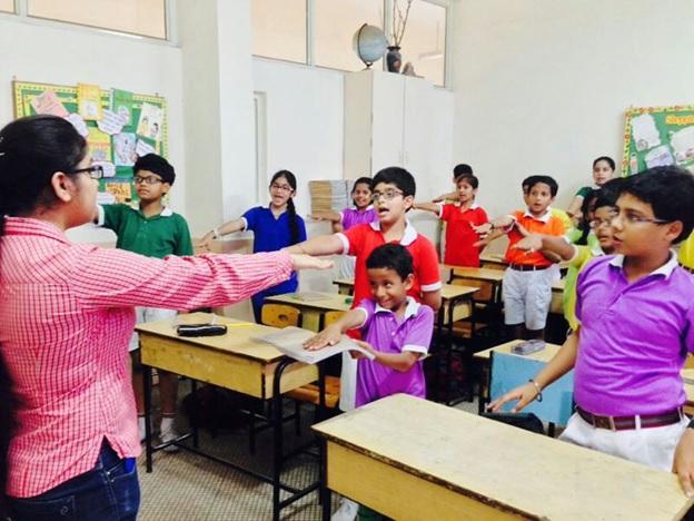 Volunteers taking school workshops