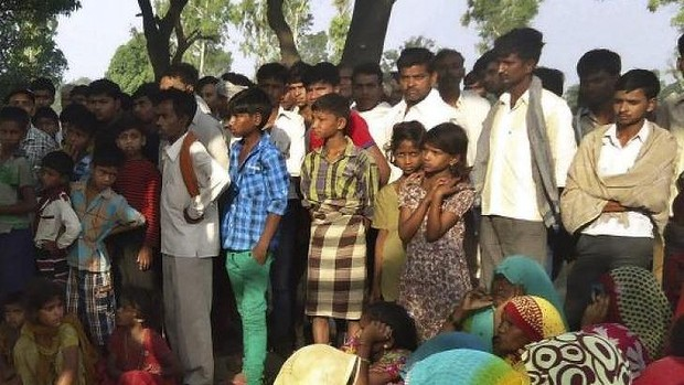 Villagers stare at the hanging bodies of the two minors raped in Uttar Pradesh.