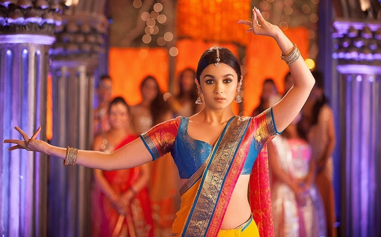 According to Bollywood, we break into a Bharatnatyam during an on going Bhangra at a wedding. Some fun bunch, we are. eh?