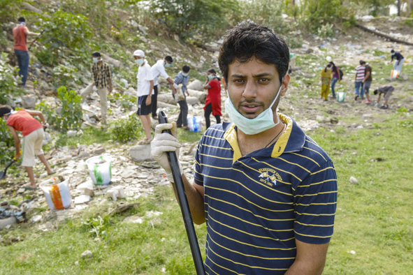 Arun Krishnamurthy, pictured during the clean-up of Lake Kilkattalai, is determined that India's urban lakes will not disappear through neglect. Chennai, India, 2012