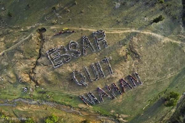 A human banner in Mahan in protest against deforestation for mining.