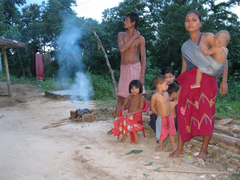 Traditional way of burning rags and rice husks at dawn to keep away mosquitoes.