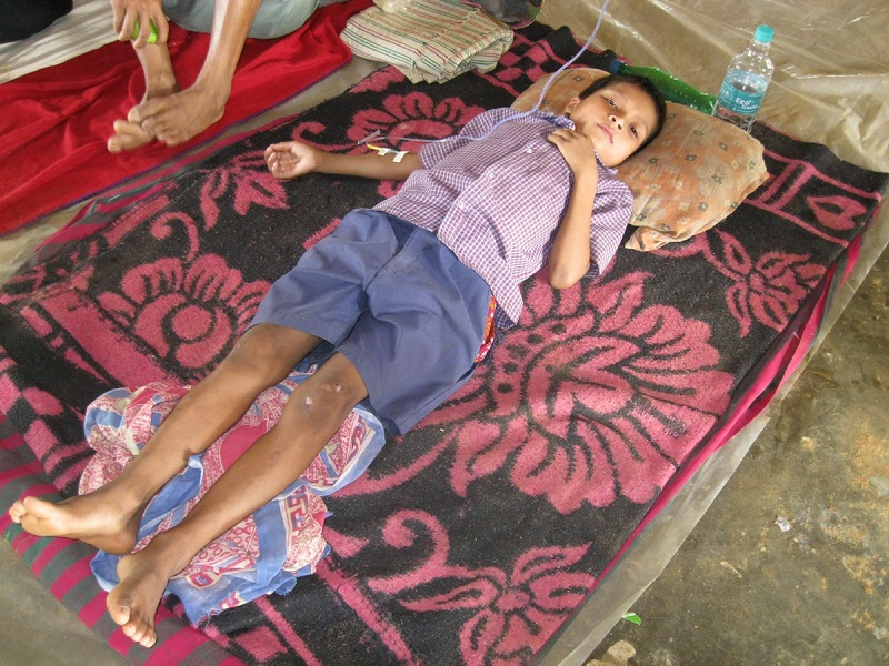 Ananta, an 8-year-old boy at the temporary health centre set up in Mungiakami village on the evening of 3rd July.