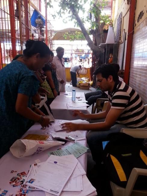 A camp conducted by Karur Vyasa Bank, in Kamraj Nagar, a slum in Mumbai's eastern Ghatkopar suburb, to open bank accounts under the Jan Dhan Yojana