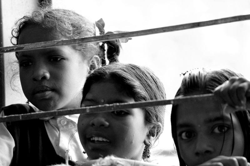 Haq Banta Hai: A group of girl child peeks through a school window in a village in Chhattisgarh. Photo credit: Amit Sengupta