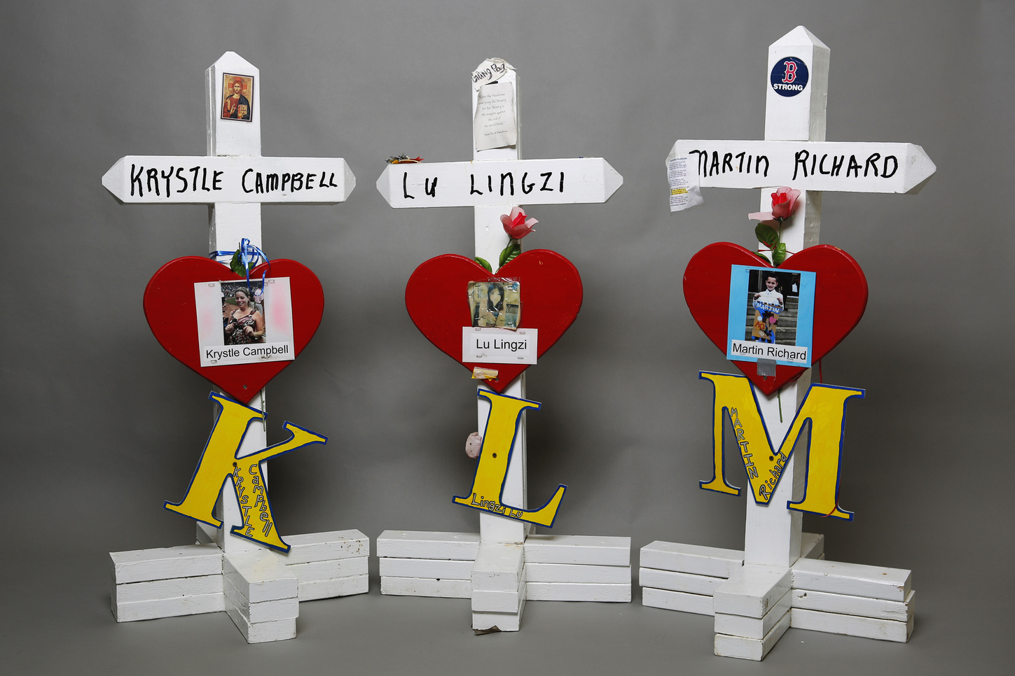 Crosses for Boston Marathon bombing victims Krystle Campbell, Lu Lingzi and Martin Richard, artifacts saved from the makeshift Boston Marathon bombing memorial.  REUTERS/Brian Snyder
