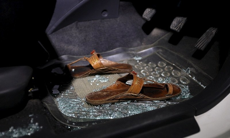 """A pair of sandals lies amid broken glass in a car after the murder of Sabeen"" from Dawn.com"