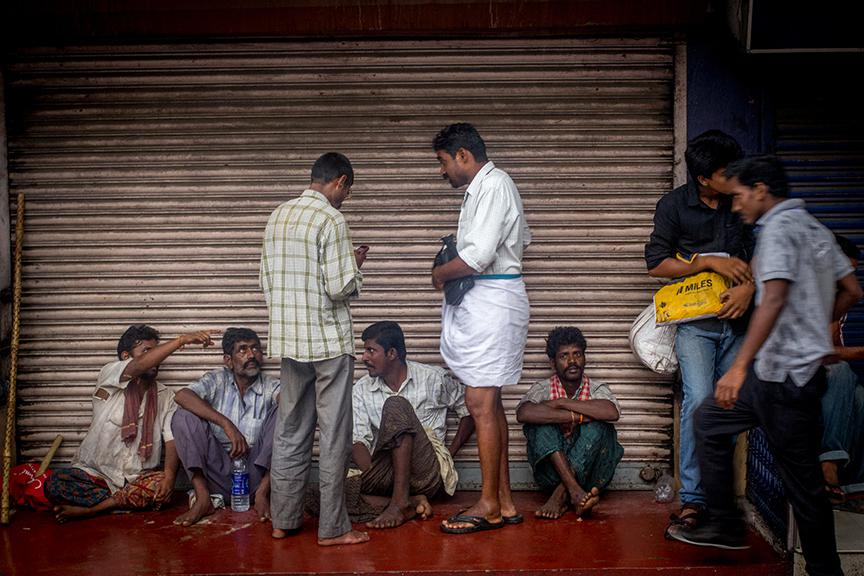 A man selling lottery tickets to migrant labour from anantapur at kaloor junction