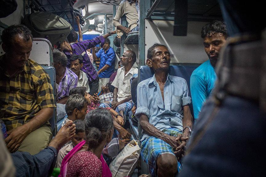 Exhausted migrants, on the Kochi- Kadiri train