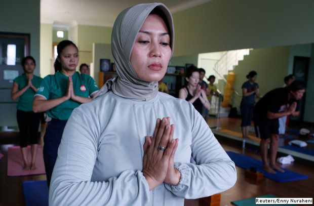 A Muslim woman attending a yoga lesson in Bandung, Indonesia. Indonesia is one of 47 Islamic nations that supported the creation of an International Yoga Day.