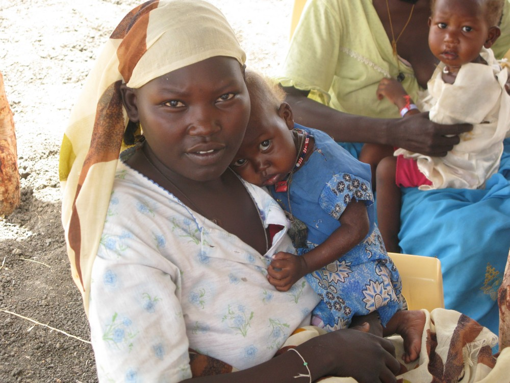 Mother with child in sudan. Image source: Wikimedia Commons