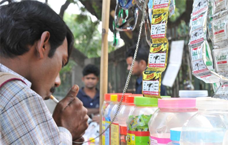 indian man smoking tobacco