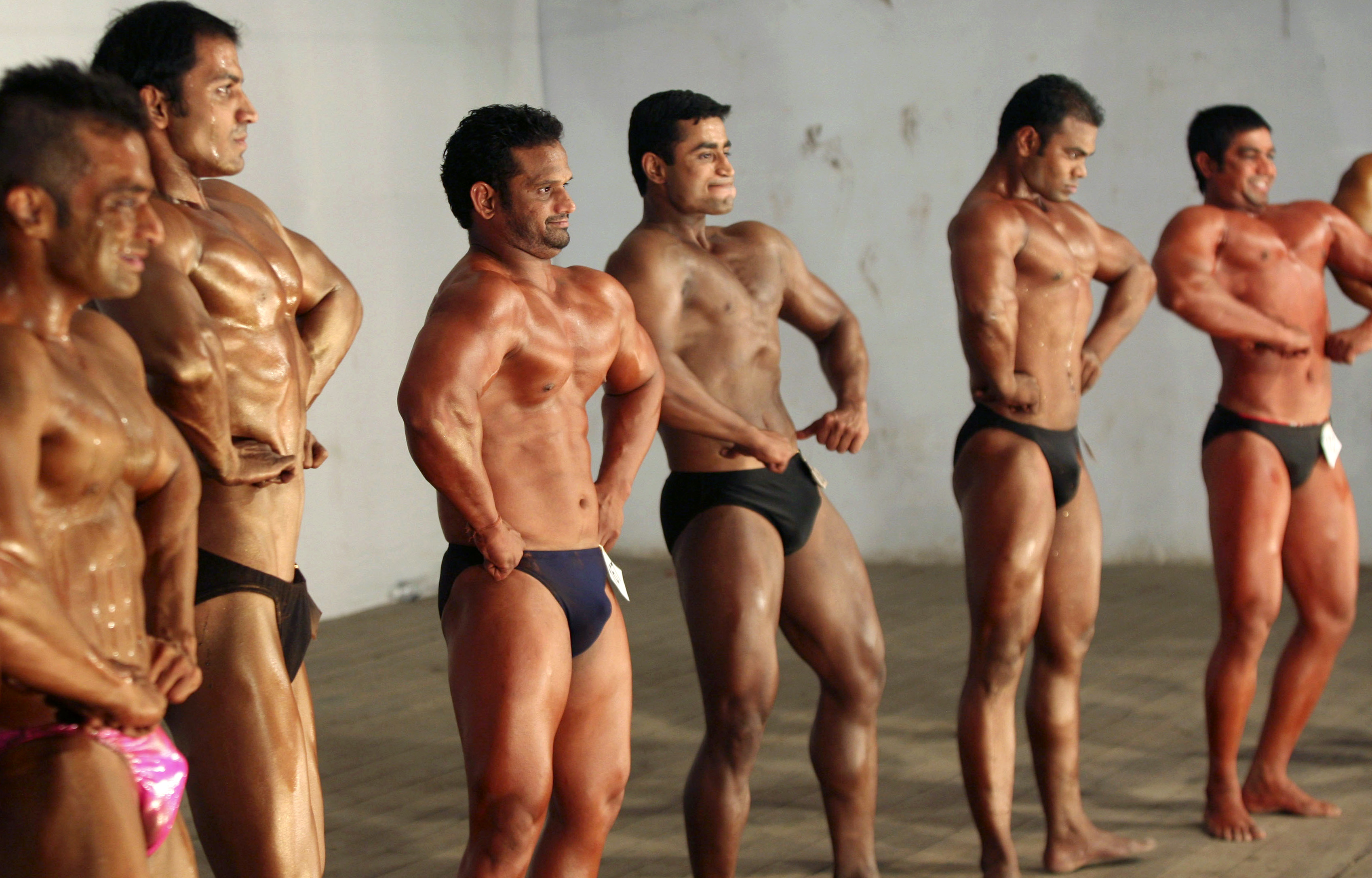 "Competitors flex their muscles during the ""Mr. Senior Gujarat 2010"" bodybuilding contest in the western Indian city of Ahmedabad January 31, 2010. More than 200 body builders across the state on Sunday participated in a contest organised by the Gujarat state body building association in an aim to encourage youth in body building sports and to aware common people about their health, a media release said. Picture taken January 31, 2010. REUTERS/Amit Dave"