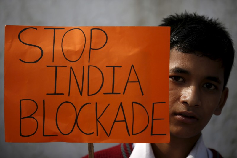 A student holding a placard takes part in a protest to show solidarity against the border blockade in Kathmandu, Nepal November 27, 2015. The middle hills and the capital Kathmandu have suffered fuel and cooking gas shortages after protesters in the south switched to blocking supplies from India, Nepal's largest trading partner, almost two months ago. Many in Nepal accuse India of supporting the protesters - a charge New Delhi denies. India has expressed its dissatisfaction with parts of the constitution, although it also says it cannot allow trucks to enter Nepal while conditions are unsafe. REUTERS/Navesh Chitrakar  - RTX1W3C8