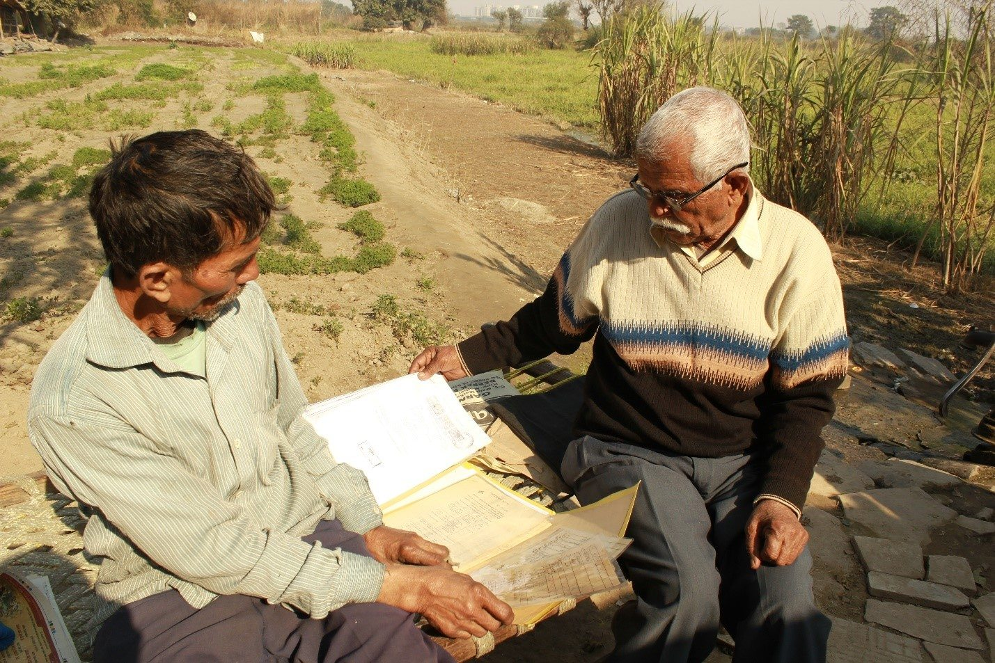 Budh Ram, 62 and Anoop Singh were quick to show the documents of the land and of the case they have been fighting against DDA since 2014 for the right to live on that stretch of land.