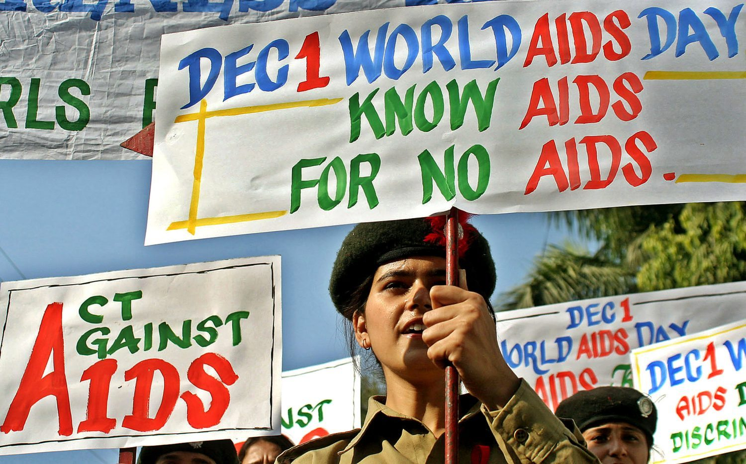 Indian members of National Cadet Corps (NCC) hold placards during an AIDS awareness rally in the northern Indian city of Jammu December 1, 2005. India, with the world's second largest number of HIV/AIDS cases, must shed its inhibitions and start talking openly about safe sex to protect itself against the epidemic, Prime Minister Manmohan Singh said on Thursday. REUTERS/Amit Gupta - RTR19SKU