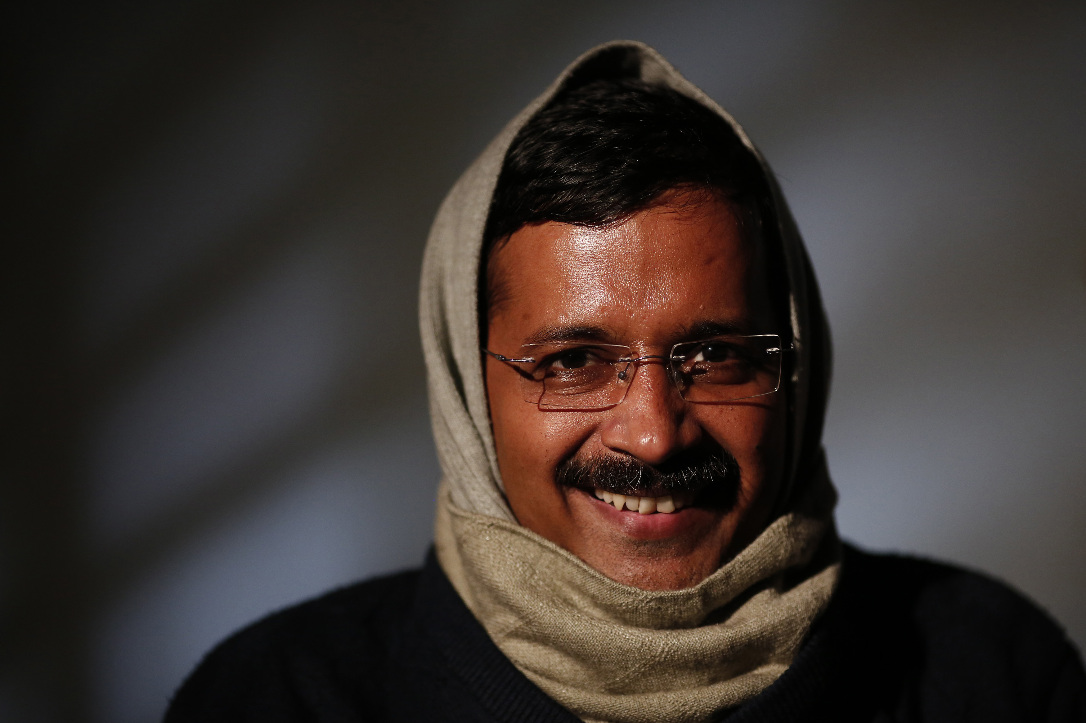 Delhi's Chief Minister Arvind Kejriwal, chief of the Aam Aadmi (Common Man) Party (AAP), smiles during an interview with Reuters at his residence on the outskirts of New Delhi January 27, 2014. The young anti-graft party that stormed to power in India's capital last month plans to field at least 73 candidates in national elections due by May to stand against politicians accused of crimes, its founder said on Monday. Following its strong performance in Delhi, interest in the year-old Aam Aadmi Party (AAP) has surged. Since an announcement earlier this month that it would contest the general election, its membership has passed 10 million. Picture taken January 27, 2014. REUTERS/Adnan Abidi (INDIA - Tags: POLITICS HEADSHOT) - RTX17XTW