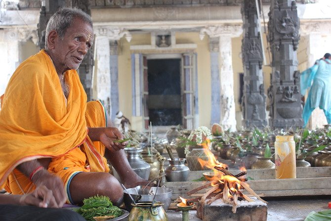 A Tamil Jain priest preparing for a puja on Mahavir Jayanthi. Image source: SouthAsia@LSE