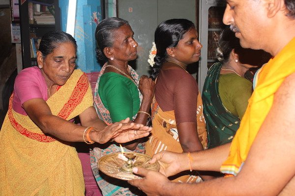 Tamil Jain women who hail from agricultural families at a puja on Mahavir Jayathi at Mel Sithamoor. The priest is a professional working in the city. Image source: SouthAsia@LSE
