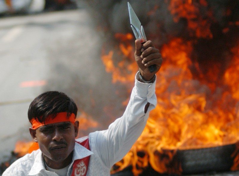 An activist from the hardline Hindu group Bajrang Dal, attends a protest rally in the northern Indian city of Lucknow September 12, 2007. Thousands of activists gathered on Wednesday to take part in a nation wide protest rally against the controversial project to carve a shipping channel in seas off the Indian south coast despite protests by religious groups who say it will destroy a mythical bridge of sand made by a Hindu god. REUTERS/Pawan Kumar (INDIA) - RTR1TR6H