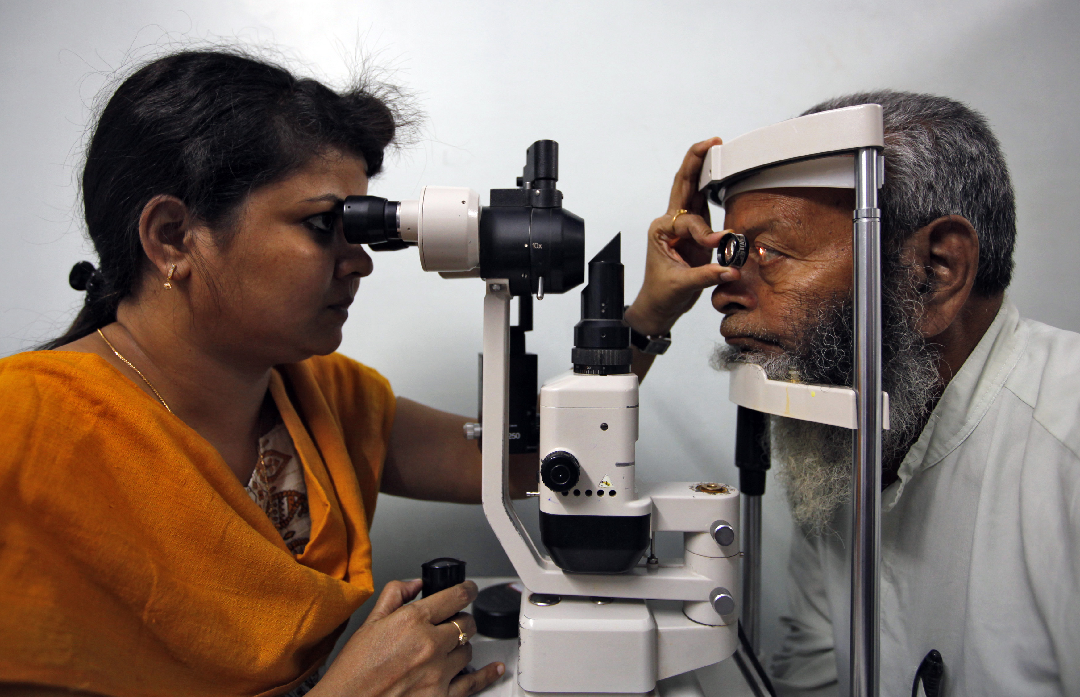 A villager undergoes an eye examination at a camp organised by Aravind Eye Care System in a village outside Madurai, in India's Tamil Nadu state March 3, 2010 to screen for eye problems which will then be treated at one of their hospitals. From a rented house with 11 beds in 1976, Aravind, whose mission is to eliminate needless blindness, has grown into a network of hospitals and clinics that provides eye examinations, surgery by keeping its costs extremely low and by subsidizing care for poor people through fees for paying customers and the sale of eye-care products. Picture taken March 3, 2010.  REUTERS/Reinhard Krause (INDIA - Tags: HEALTH SOCIETY) - RTR2B9T5