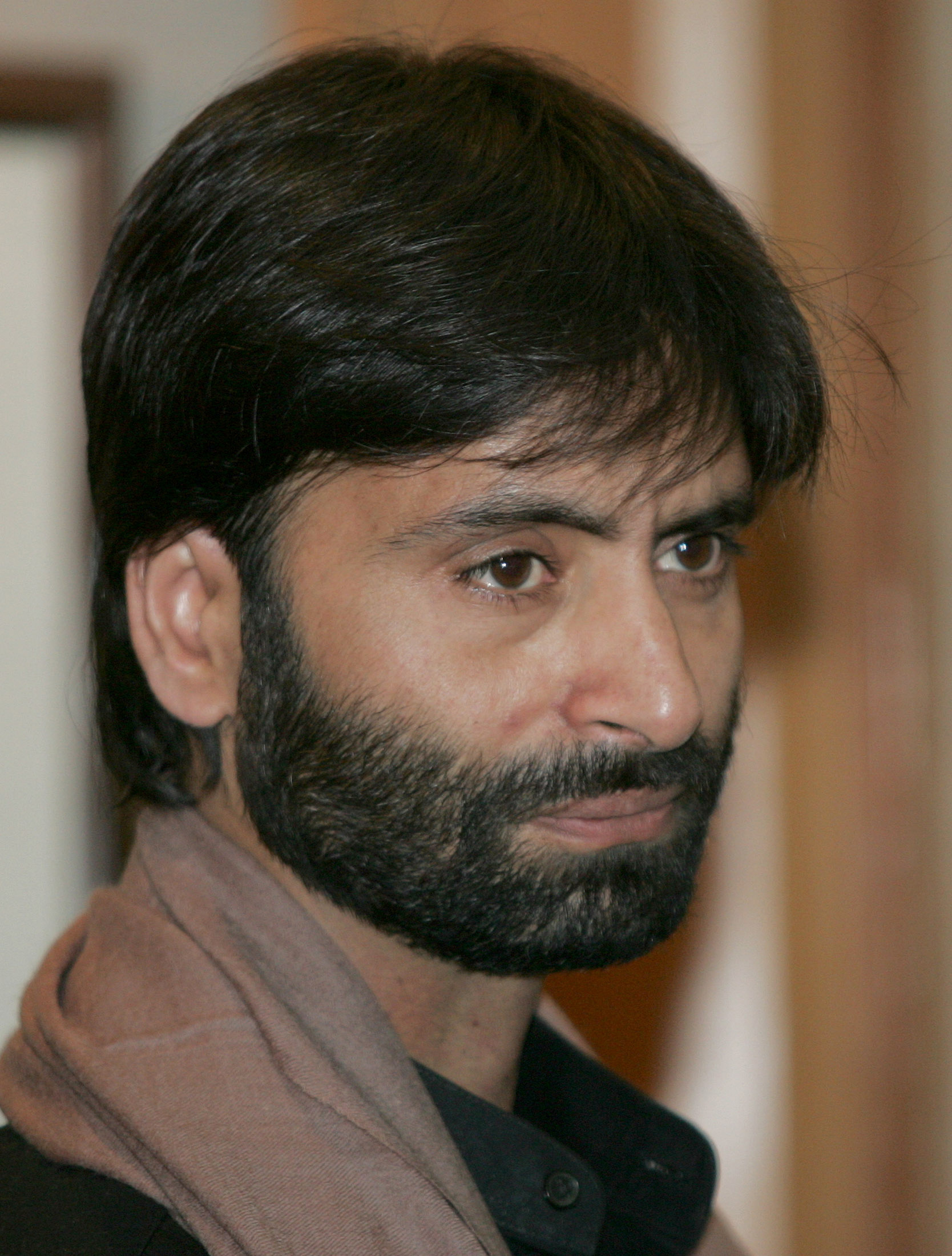 Yasin Malik, chief of Jammu and Kashmir Liberation Front (JKLF) attends a meeting with Indian Prime Minister Manmohan Singh in New Delhi February 17, 2006. REUTERS/B Mathur - RTR16BH3