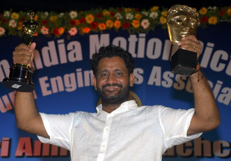 "Resul Pookutty displays his Oscar and Bafta award trophies, after receiving an award from Bollywood actor Amitabh Bachchan, for his contribution to sound industry on behalf of western India motion pictures and television sound engineers association during an award function in Mumbai May 5, 2009. Pookutty was the winner of the Oscar for sound mixing for ""Slumdog Millionaire"" during the 81st Academy Awards. Picture taken May 5, 2009. REUTERS/Manav Manglani (INDIA ENTERTAINMENT) - RTXERSU"