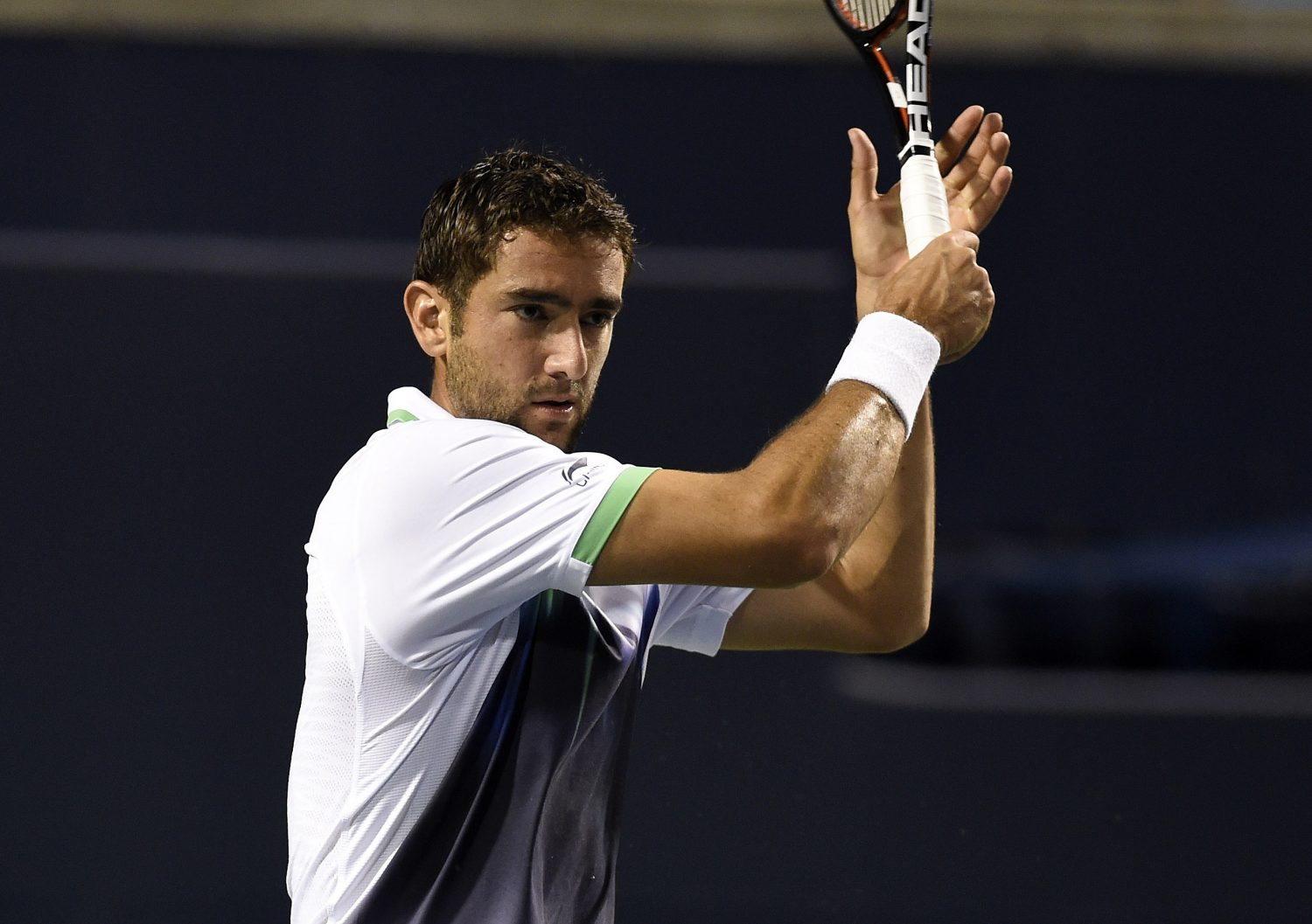 Aug 7, 2014; Toronto, Ontario, Canada; Marian Cilic (CRO) plays a forehand against Roger Federer (SUI) on day four of the Rogers Cup tennis tournament at Rexall Centre. Mandatory Credit: Peter Llewellyn-USA TODAY Sports - RTR41N8G