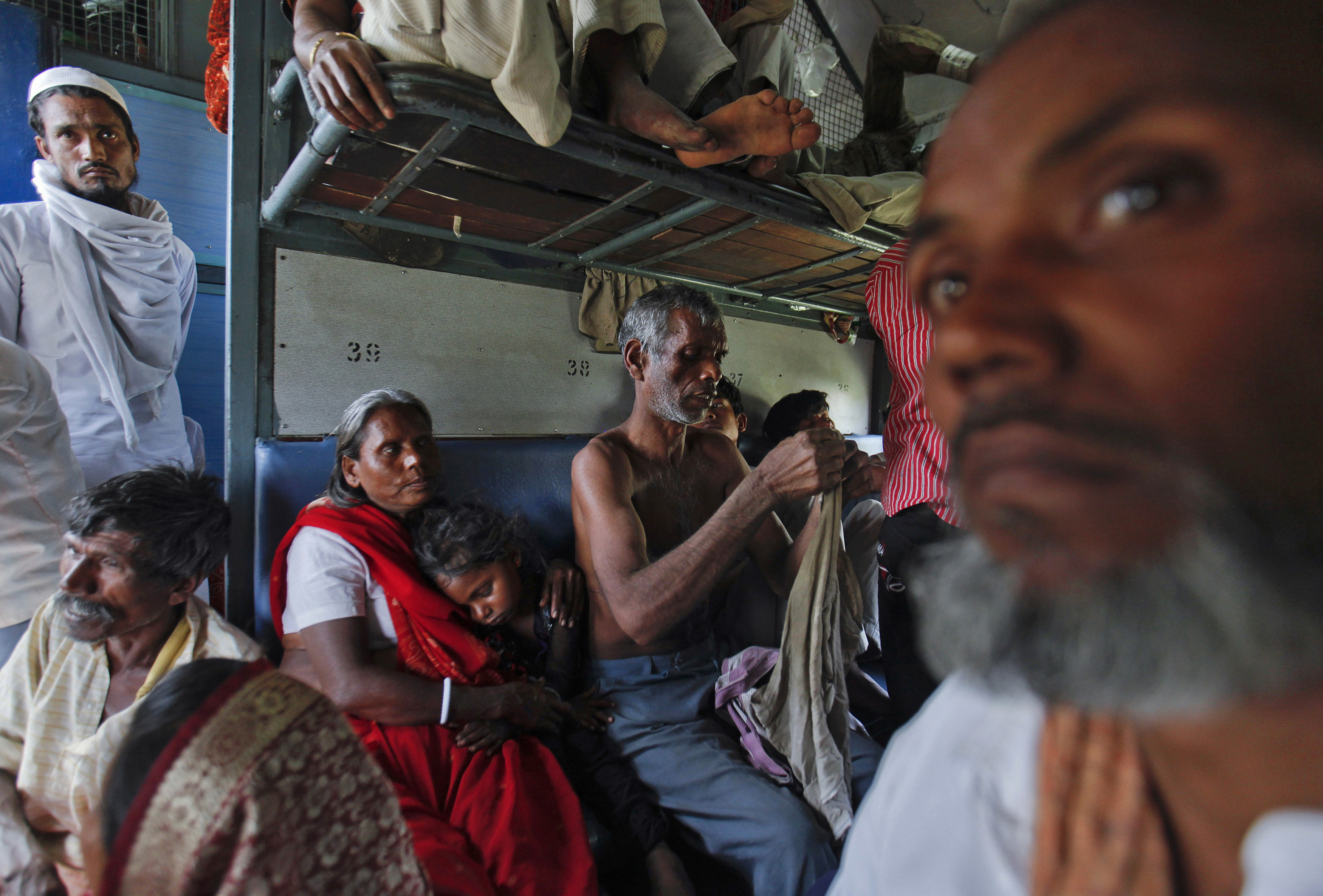 Passengers travel inside an overcrowded general class compartment of the Kalka Mail train in the northern Indian city of Kanpur March 20, 2012. By the end of the day, about 40 people on average will have died somewhere on the network of 64,000 km (39,800 miles) of track. Many will be slum-dwellers and poor villagers who live near the lines and use them as places to wash and as open toilets. Some will have fallen off overcrowded commuter trains. Of the 20 million people who travel daily on the network, many will arrive hours, even a day, behind schedule, having clattered along tracks and been guided by signalling systems  built before India gained independence from Britain in 1947.  To match Insight INDIA-RAILWAYS  REUTERS/Danish Siddiqui (INDIA - Tags: TRANSPORT SOCIETY POLITICS BUSINESS) - RTR2ZOS4