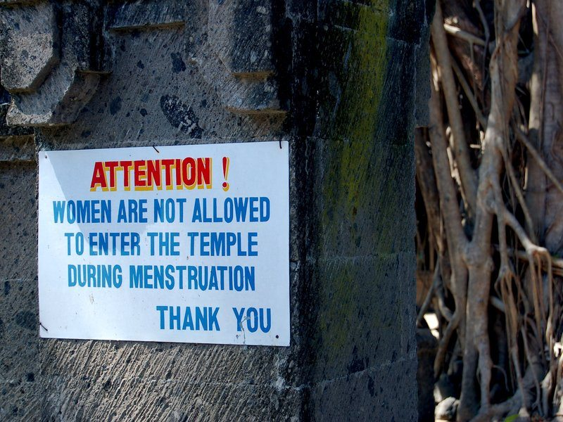 Board outside temple prohibiting entry of women during their menstrual period.