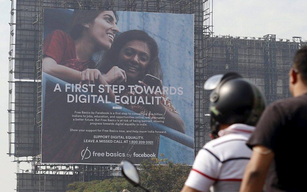 Motorists ride past a billboard displaying Facebook's Free Basics initiative in Mumbai, India, December 30, 2015. India has become a battleground over the right to unrestricted Internet access, with local tech start-ups joining the front line against Facebook Inc founder Mark Zuckerberg and his plan to roll out free Internet to the country's masses. The Indian government has ordered Facebook's Free Basics plan on hold while it decides what to do. Picture taken December 30, 2015. REUTERS/Danish Siddiqui - RTX20L66
