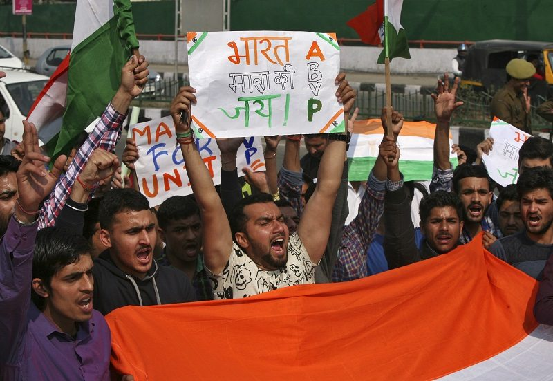 "Activists from the Akhil Bharatiya Vidyarthi Parishad (ABVP), the student wing of India's ruling Bharatiya Janata Party (BJP), raise their hands as they shout slogans during a protest march in Jammu February 25, 2016. Dozens of ABVP members on Thursday carried out the march against ""anti-national sloganeering"" raised at the Jawaharlal Nehru University (JNU) campus earlier this month, protestors said. REUTERS/Mukesh Gupta - RTX28ICI"