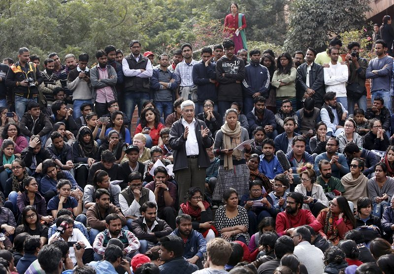 Prakash Karat (centre L), a leader of Communist Party of India (Marxist) (CPI-M), addresses students of Jawaharlal Nehru University (JNU) during a protest inside the university campus in New Delhi, India, February 15, 2016. India's biggest nationwide student protests in a quarter of a century spread across campuses on Monday after the arrest of a student accused of sedition, in the latest battle with Prime Minister Narendra Modi's government over freedom of expression. Outrage over the arrest of the left-wing student leader, who had organized a rally to mark the anniversary of the execution of a Kashmiri separatist, has led to demonstrations in at least 18 universities. REUTERS/Anindito Mukherjee - RTX270BA