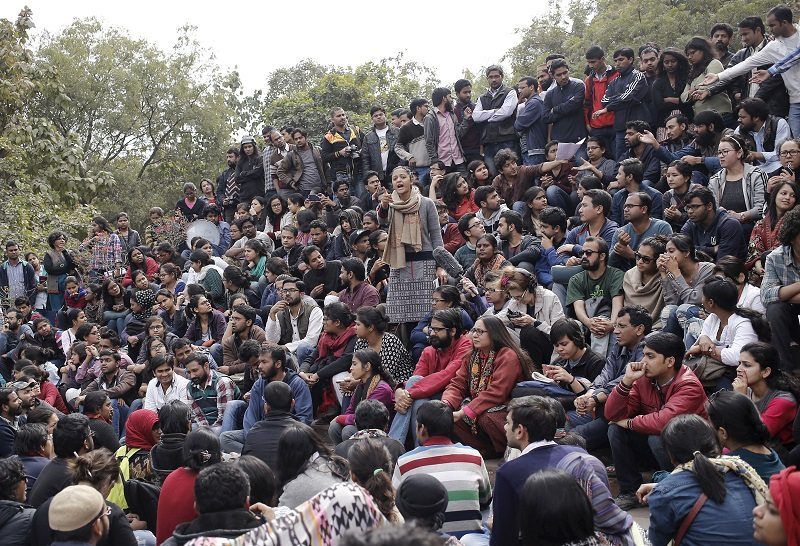 Students of Jawaharlal Nehru University (JNU) attend a protest inside the university campus in New Delhi, India, February 15, 2016. India's biggest nationwide student protests in a quarter of a century spread across campuses on Monday after the arrest of a student accused of sedition, in the latest battle with Prime Minister Narendra Modi's government over freedom of expression. Outrage over the arrest of the left-wing student leader, who had organized a rally to mark the anniversary of the execution of a Kashmiri separatist, has led to demonstrations in at least 18 universities. REUTERS/Anindito Mukherjee - RTX270B7