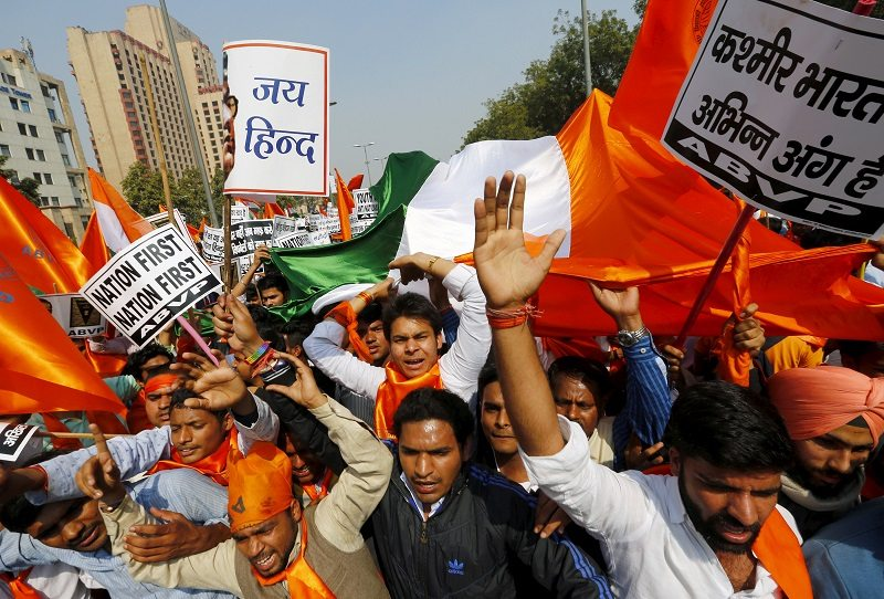 "Activists from the Akhil Bharatiya Vidyarthi Parishad (ABVP), the student wing of India's ruling Bharatiya Janata Party (BJP), shout slogans during a protest march in New Delhi, India, February 24, 2016. Thousands of ABVP members on Wednesday carried out the march against ""anti-national sloganeering"" raised at the Jawaharlal Nehru University (JNU) campus earlier this month, protesters said. REUTERS/Adnan Abidi - RTX28BSL"