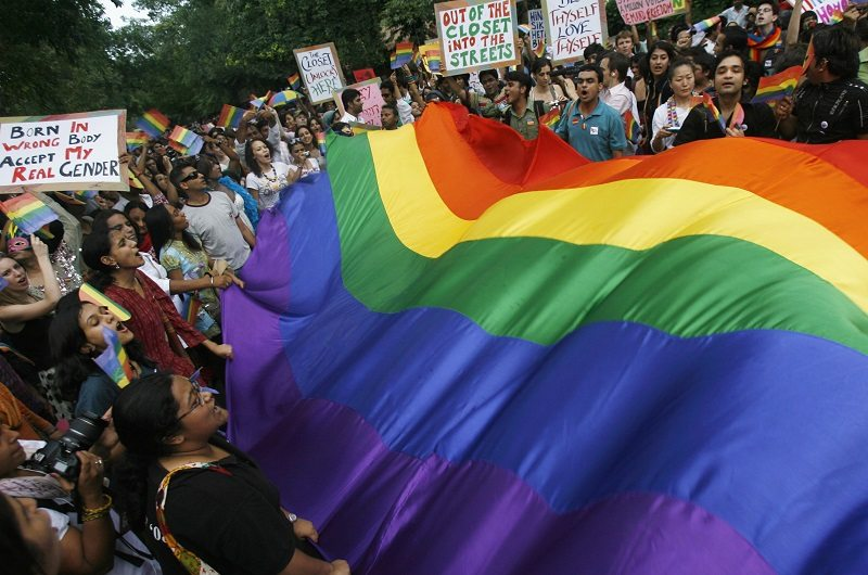 "Gay rights activists display a rainbow flag during ""Queer Pride March"" in New Delhi June 29, 2008. Hundreds of gay activists on Sunday took part in the march to raise awareness about their rights. REUTERS/Adnan Abidi (INDIA) - RTX7GKD"