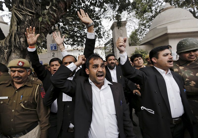 "Lawyers shout slogans outside the Patiala House court in New Delhi, India, February 19, 2016. Dozens of lawyers on Friday held a protest march demanding action against what they call ""anti-nationalists"" supporting Kanhaiya Kumar, a Jawaharlal Nehru University student union leader accused of sedition. REUTERS/Anindito Mukherjee - RTX27OMT"