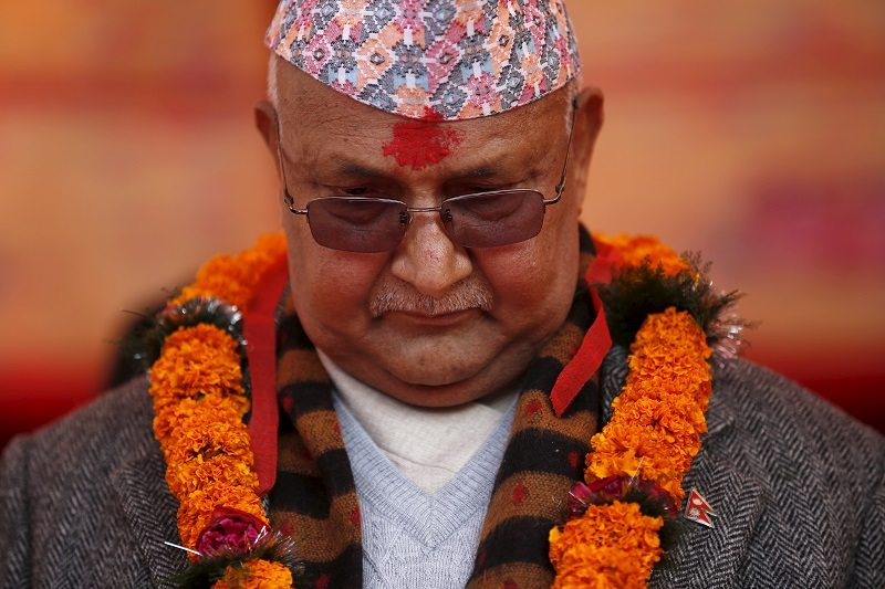 Nepal's Prime Minister Khadga Prasad Sharma Oli, also known as KP Oli, observes a minute of silence for earthquake victims during an event organised to mark the 18th National Earthquake Safety Day and the official launch of earthquake reconstruction efforts in Bungamati village, Nepal January 16, 2016. REUTERS/Navesh Chitrakar - RTX22MXW
