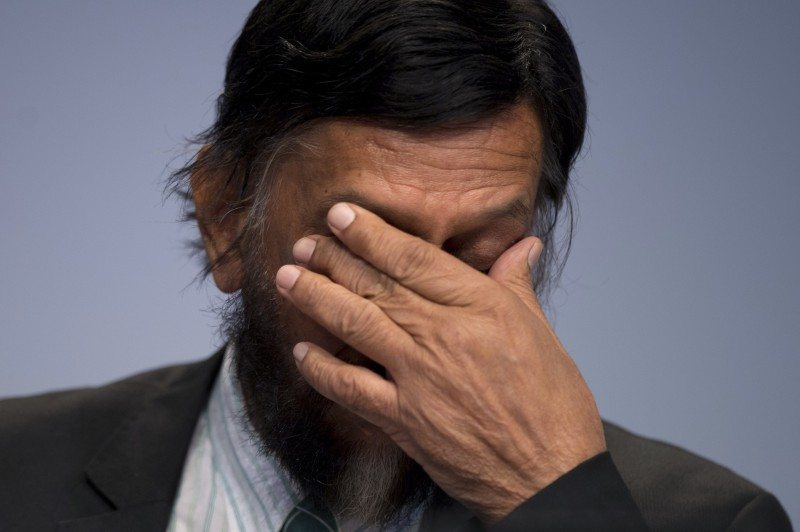 IPCC Working Group III Chairman Rajendra Pachauri gestures as he attends a news conference to present Working Group III's summary for policymakers at The Intergovernmental Panel on Climate Change (IPCC) in Berlin April 13, 2014. REUTERS/Steffi Loos (GERMANY - Tags: POLITICS ENVIRONMENT) - RTR3L1TN