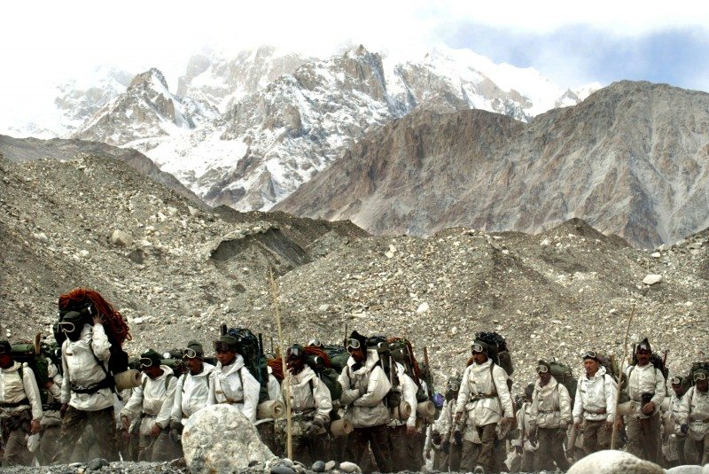 Indian army soldiers muster at the base camp after coming back from training at Siachen Glacier, October 4, 2003. For 18 years, Pakistani and Indian soldiers have clung to Siachen, which lies north of the end of the Line of Control dividing disputed Kashmir, and just below the border with China. [Siachen is 78 km (48 miles) long and lies at an altitude of 5,400 metres, the world's highest battlefield with temperatures as low as - 60ºC (-76 Farenheit). Picture taken October 4, 2003.] - RTXM8MF