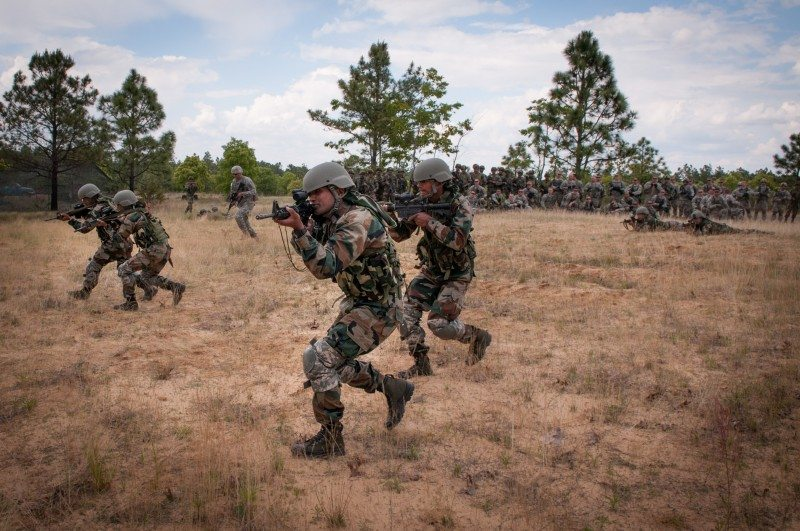Indian Army soldiers with the 99th Mountain Brigade's 2nd Battalion, 5th Gurkha Rifles, execute an ambush for paratroopers with the U.S. Army's 1st Brigade Combat Team, 82nd Airborne Division, May 7, 2013, at Fort Bragg, N.C. The soldiers are participating in Yudh Abhyas, an annual bilateral training event between the armies of the United States and India sponsored by U.S. Army Pacific. (U.S. Army photo by Sgt. Michael J. MacLeod)