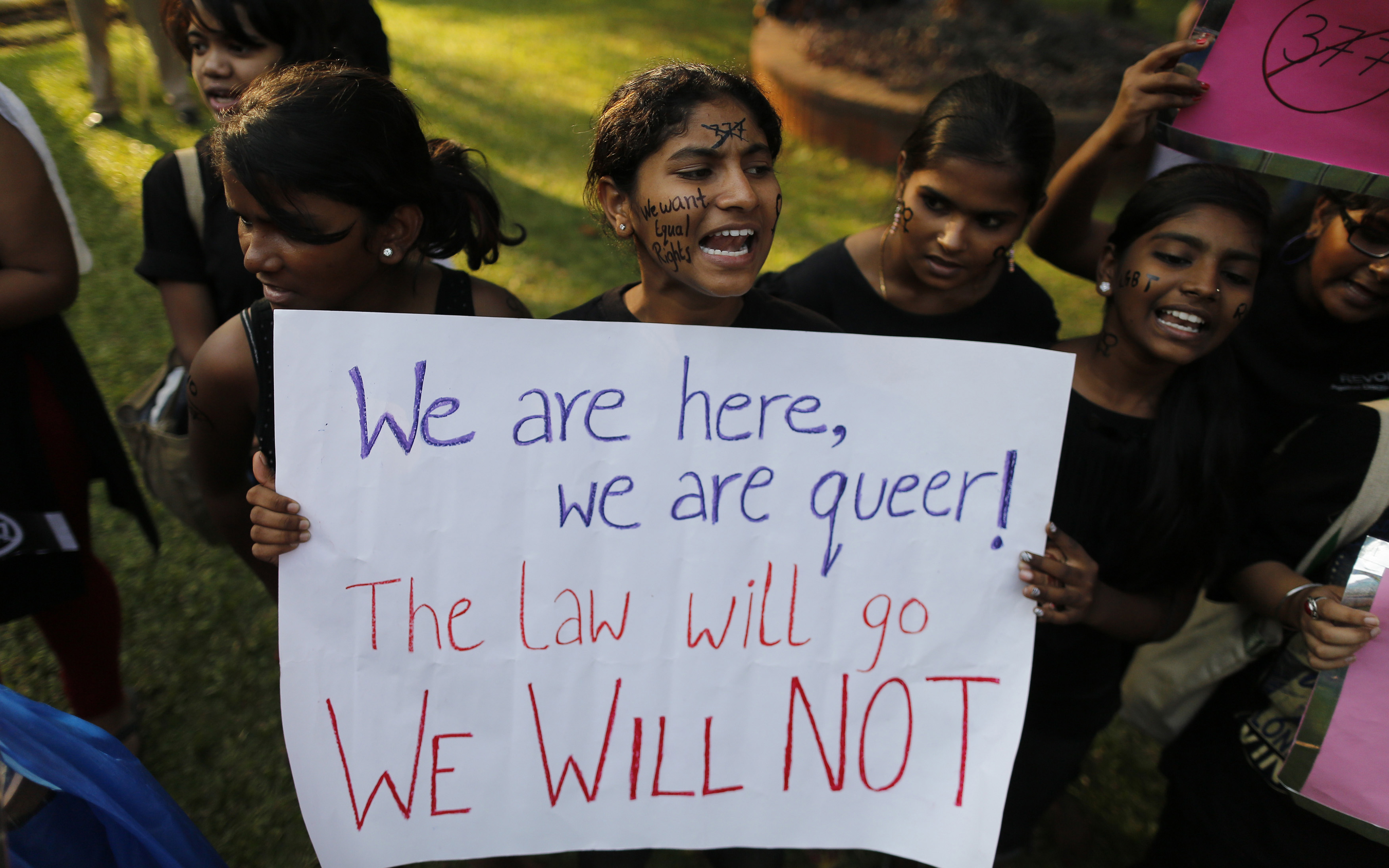 "Gay rights activists shout slogans during a protest against the verdict by the Supreme Court in Mumbai December 15, 2013. India's Supreme Court on Wednesday reinstated a ban on gay sex in the world's largest democracy, following a four-year period of decriminalisation that had helped bring homosexuality into the open in the socially conservative country. In 2009 the Delhi High Court ruled unconstitutional a section of the penal code dating back to 1860 that prohibits ""carnal intercourse against the order of nature with any man, woman or animal"" and lifted the ban for consenting adults. The Supreme Court threw out that decision, saying only parliament could change Section 377 of the penal code, widely interpreted to refer to homosexual sex. Violation of the law can be punished with up to 10 years in jail. REUTERS/Danish Siddiqui (INDIA - Tags: LAW SOCIETY) - RTX16JJD"